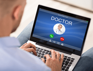 Covered California Online Doctor Male On Laptop